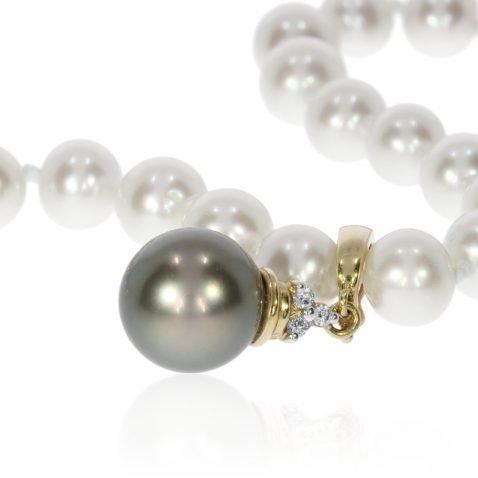 Tahitian Pearl and Diamond Enhancer P875 on Pearls