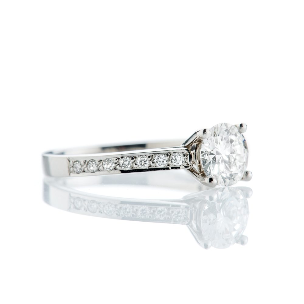 Magnificent Diamond and Platinum Engagement Ring With Diamond Set Shoulders