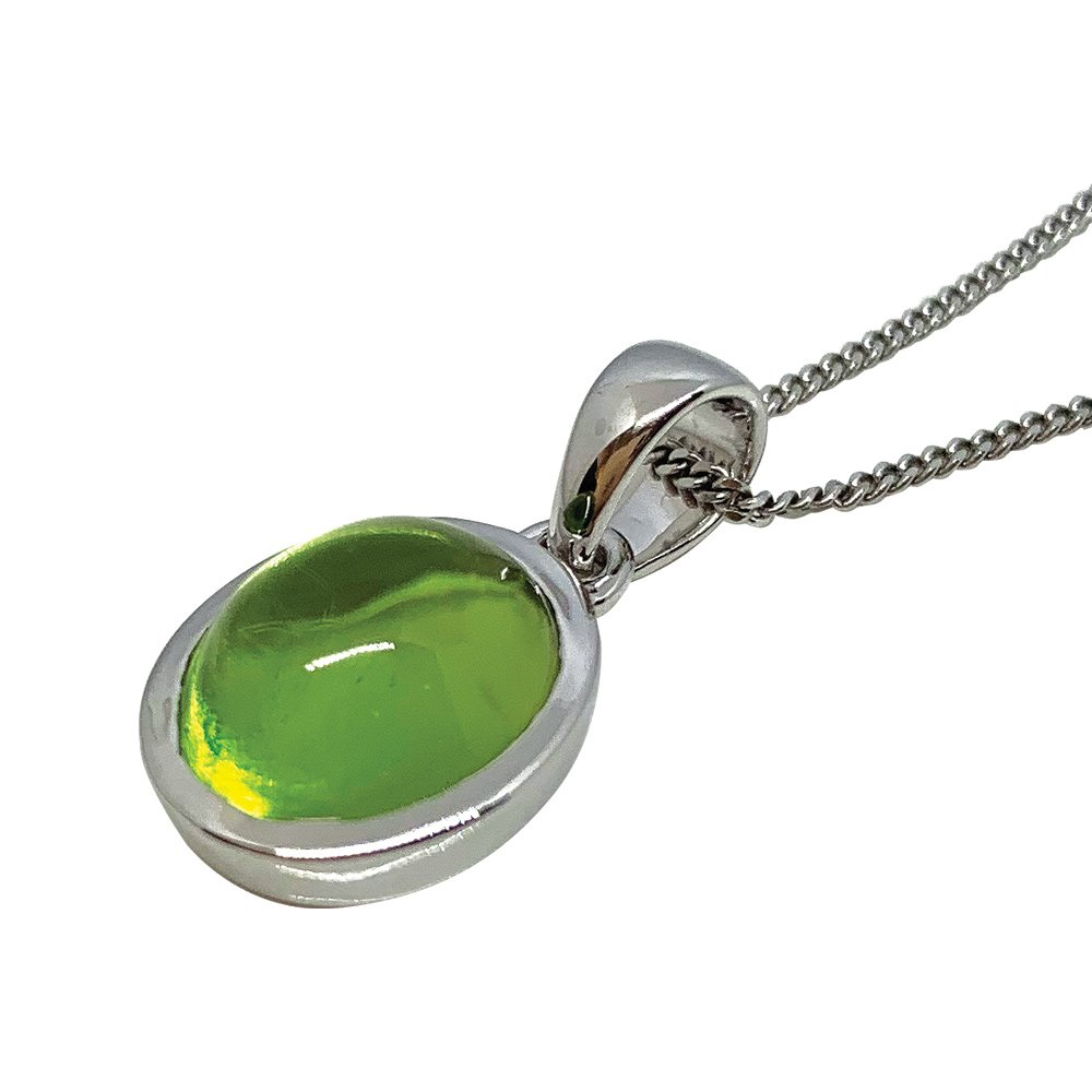 Peridot oval cabochon and 9ct white Gold pendant