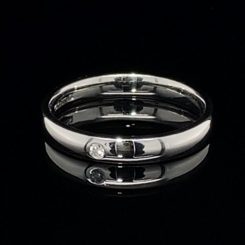 Diamond and White Gold Stacking Ring on black