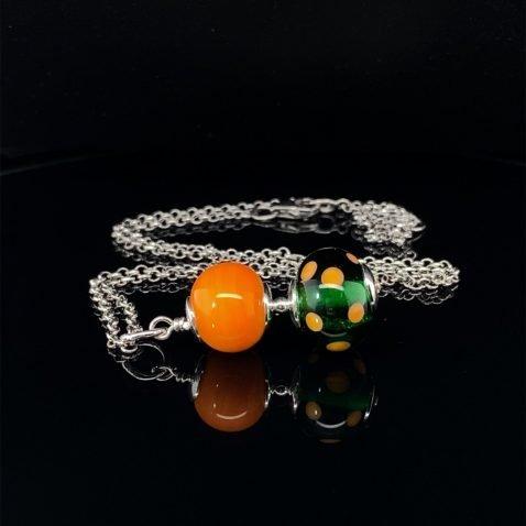 Glorious Orange and Green Murano Glass Pendant on black by Heidi Kjeldsen Jewellery