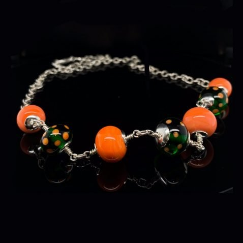 Orange and green murano glass necklace by Heidi Kjeldsen Jewellery NL1273 on black