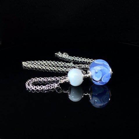 Blue and white floral Murano glass pendant by Heidi Kjeldsen Jewellery P1412 on black