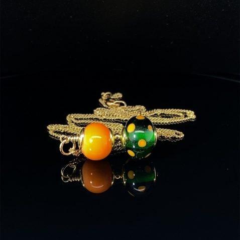 Fascinating Orange and Green Murano Glass Pendant By Heidi Kjeldsen On Black