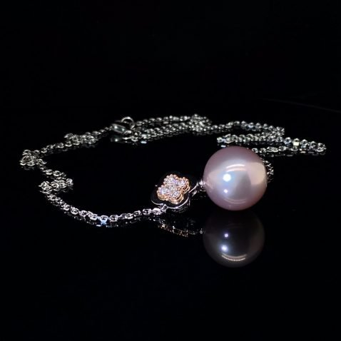 Lustrous Pink Pearl and Diamond Rose and White Gold Pendant on black A