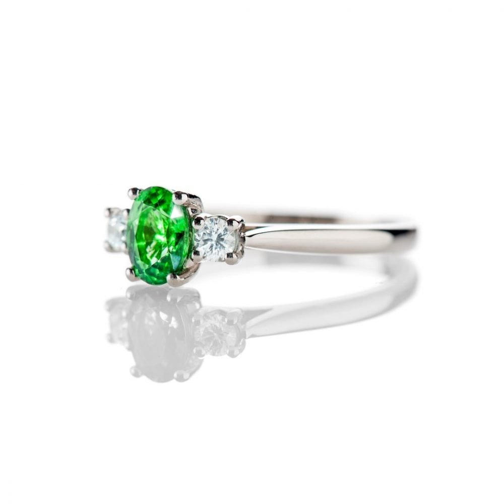 Tsavorite is a rare form of Garnet which is green.  This ring is made in Platinum and has a Diamond either side of the oval Tsavorite and as January's birthstone is a perfect gift.